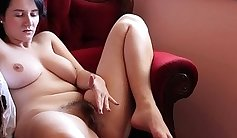 Busty Brunette Masturbating Her Hairy Pussy