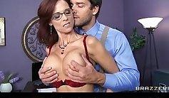 Busty beauty Syren De Mer flexing her manhood