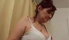 Busty granny masturbates her hairy pussy with fingers