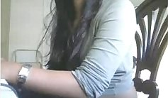 somewhat sporty Indian girl show her boobs using her glasses on web cam
