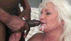 Cuffed interracial granny plowed