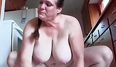 Busty granny banged in kitchen