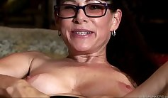 Brunette Tina rubs her pussy using big toys